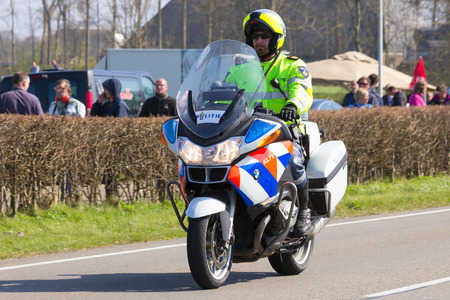 police unit: LEEUWARDEN, NETHERLANDS - 15 APRIL, 2015: A Dutch BMW R1200RT-P Police motorcycle on patrol. T