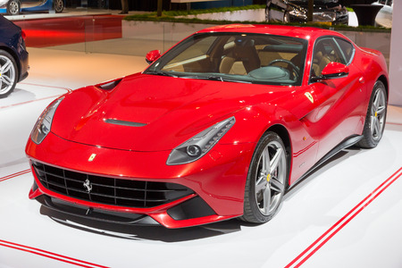 replaces: AMSTERDAM - APRIL 16, 2015: Ferrari F12 Berlinetta sports car at the AutoRAI 2015. The F12 debuted in 2012 and replaces the 599 series grand tourers.