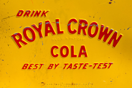 advertise with us: DEN BOSCH, NETHERLANDS - MAY 10, 2015: Royal Crown Cola logo on a vintage vending machine. The soft drink is developed in 1905 by Claud A. Hatcher, a pharmacist in Columbus, Georgia, United States. Editorial