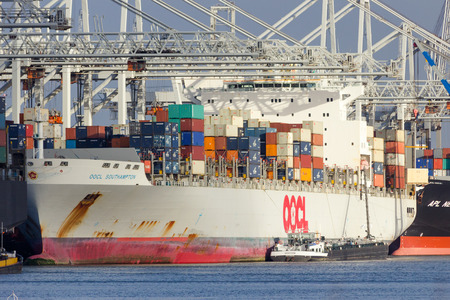 ROTTERDAM - JAN 13, 2012: OOCL Southampton container ship moored at a container terminal in the Port of Rotterdam.