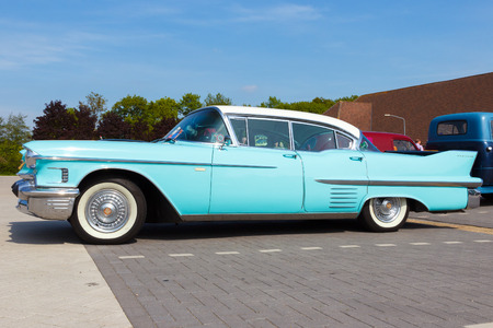 ville: DEN BOSCH, THE NETHERLANDS - MAY 10, 2015: 1958 Cadillac Sedan De Ville on the parking lot at the Rock Around The Jukebox event.
