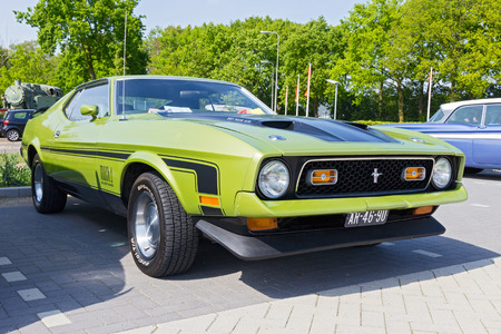 mach 1: DEN BOSCH, THE NETHERLANDS - MAY 10, 2015: 1972 Ford Mach1 on the parking lot at the Rock Around The Jukebox event. Editorial