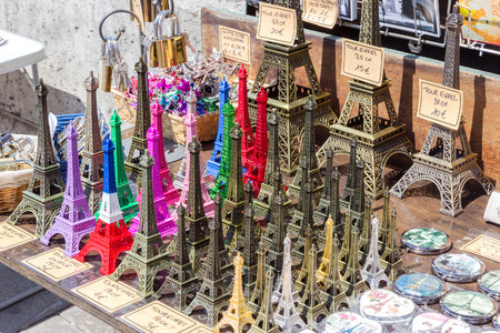 Eiffel tower statuettes being sold at a tourist stand in Paris France.