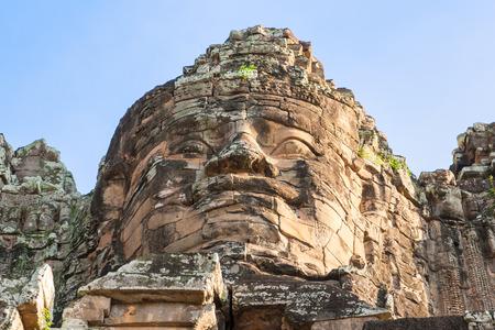 angor: One of the giant stone faces at Bayon Temple at Angkor Wat Cambodia