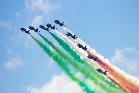 mb: VOLKEL, THE NETHERLANDS - JUNE 15, 2013: The Italian demonstration team Frecce Tricolori performing at the Dutch Air Force Open Days. The team will replace their MB339 aircraft with Alenia Aermacchi M-345 in 2017.