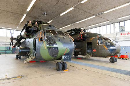 heli: RHEINE-BENTLAGE, GERMANY JUL 01, 2011: German Air Force CH-53 transport helicopters in a hangar during the open house at Rheine-Bentlage Air Base.