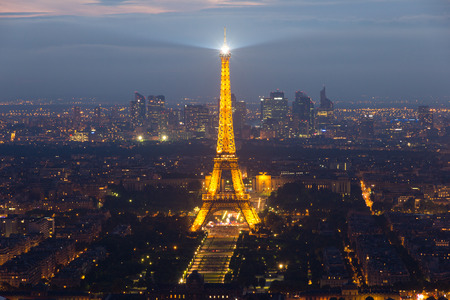 towers: PARIS  JUNE 17 2015: Evening view on Paris and the Eiffel Tower. The Eiffel tower was erected in 1889 and has become both a global cultural icon of France and the world.