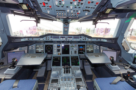 piloting: PARIS  JUN 18 2015: Airbus A380 cockpit. The A380 is the largest passenger airliner in the world.