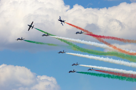 mb: VOLKEL THE NETHERLANDS  JUNE 15 2013: The Italian demonstration team Frecce Tricolori performing at the Dutch Air Force Open Days. The team will replace their MB339 aircraft with Alenia Aermacchi M345 in 2017. Editorial