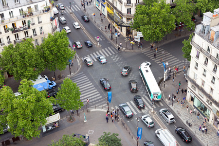 rivoli: PARIS  JUN 19 2015: View on the Rue de Rivoli crossing the Boulevard de Sbastopol. The street is one of the most famous shopping streets of Paris.