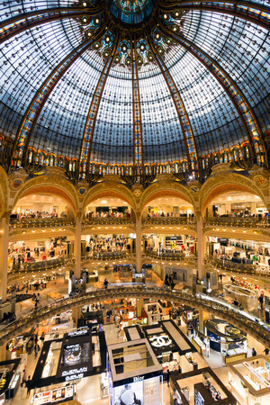 lafayette: PARIS FRANCE  JUNE 18 2015: Interior of the Galeries Lafayette in Paris. The architect Georges Chedanne designed the store where a Art Nouveau glass and steel dome was finished in 1912