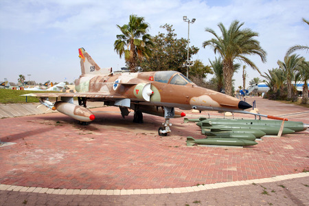 mirage: HATZERIM ISRAEL  JANUARY 27 2011: Israel Air Force Kfir C7 fighter jet  on display in the Israeli Air Force Museum. Kfir is the first made in Israel fighter aircraft made by IAI