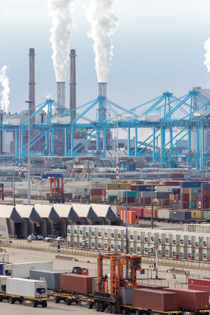 facilitate: ROTTERDAM  SEP 8: Container terminal and cranes on Sep 8 2013 in Rotterdam Netherlands. The port is the largest in Europe and facilitate the needs of a hinterland with 40000000 consumers.