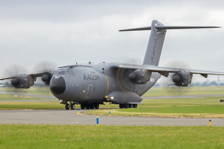 air show: PARIS-LE BOURGET - JUN 18, 2015: New Airbus A400M military transport plane taxiing before take-off at the 51st International Paris Air show