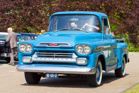 chevrolet: DEN BOSCH, THE NETHERLANDS - MAY 10, 2015: 1959 Chevrolet Apache 3100 on the parking lot at the Rock Around The Jukebox event.