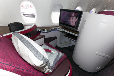 first class: PARIS - JUN 18, 2015: First Class seat in a Qatar Airways Airbus A350. Qatar Airways is the first user of the A350 with its first flight on 15 January 2015.