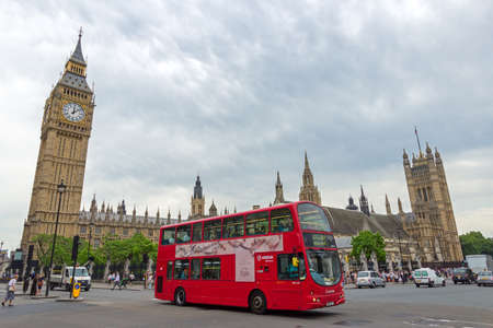 doubledecker: LONDON - JUL 01, 2015: A Double-decker bus passing the Big Ben. Editorial