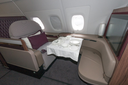first class: PARIS - JUN 18, 2015: First class seat ina Qatar Airways Airbus A380. The A380 is the largest passenger airliner in the world.