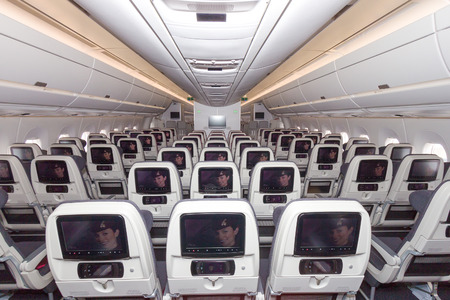 15 18: PARIS - JUN 18, 2015: Cabin view of a Qatar Airways Airbus A350. Qatar Airways is the first user of the A350 with its first flight on 15 January 2015.
