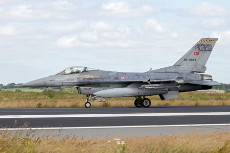 aircraft bomber: SCHLESWIG-JAGEL, GERMANY - JUN 23, 2014: Turkish Air Force F-16 fighter jet during the   Tiger Meet at Schleswig-Jagel airbase. The Tiger Meet is to promote solidarity between   air forces