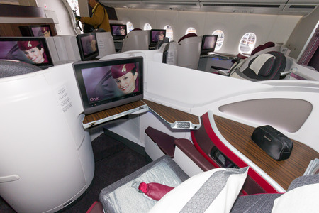 15 18: PARIS - JUN 18, 2015: First Class seat in a Qatar Airways Airbus A350. Qatar Airways is the first user of the A350 with its first flight on 15 January 2015.