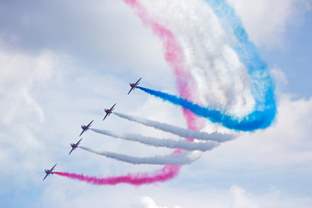 red arrows: GILZE RIJEN, THE NETHERLANDS - JUNE 21: RAF Red Arrows performing at the Dutch Air Force Open House. June 21, 2014 in Gilze-Rijen, The Netherlands