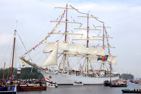 canal parade: AMSTERDAM, THE NETHERLANDS - AUGUST 19, 2015: Polish tallship Dar Mlodziezy in the North Sea Canal enroute to Amsterdam to particiate in the SAIL 2015 event.