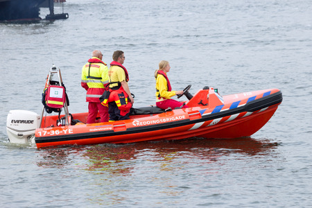 squad: AMSTERDAM, THE NETHERLANDS - AUGUST 19, 2015: Rescue squad boat in the North Sea Canal during the pre-SAIL 2015 event.