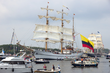 canal parade: AMSTERDAM, THE NETHERLANDS - AUGUST 19, 2015: Colombian navy tallship ARC Gloria in the North Sea Canal enroute to Amsterdam to particiate in the SAIL 2015 event.