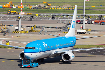 klm: AMSTERDAM - SEP 9, 2012: KLM Boeing 737 at Amsterdam-Schiphol Airport. The airport handles over 45 million passengers per year with almost 100 airlines flying from here. Editorial