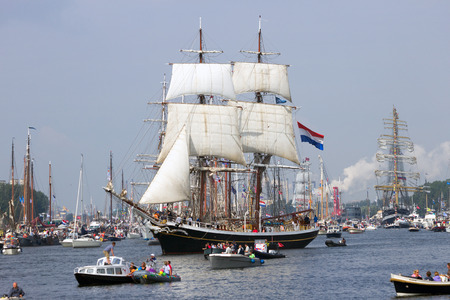 canal parade: AMSTERDAM, THE NETHERLANDS - AUGUST 19, 2015: The Sail ship Morgenster in the North Sea Canal enroute to Amsterdam to particiate in the SAIL 2015 event.