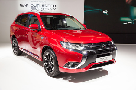 iaa: FRANKFURT, GERMANY - SEP 16, 2015: European Premiere of the new 2016 Mitsubishi Outlander PHEV at the IAA 2015. Editorial
