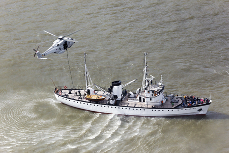 anti piracy: ROTTERDAM, THE NETHERLANDS - SEP 15, 2015: Anti-piracy demonstration with Dutch marines entering a vessel from a NH90 helicopter during the World Harbor Days in Rotterdam. Editorial