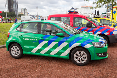 presented: ROTTERDAM, NETHERLANDS: SEP 5, 2015: New priority vehicle presented at the World Harbor Days. The green priority vehicle personnel of the security can now drive safer and faster through traffic.