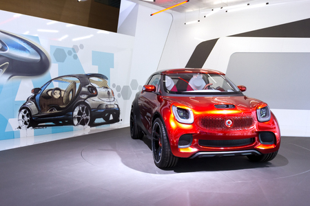 motor show: FRANKFURT, GERMANY - SEP 13: Smart forstars at the IAA motor show on Sep 13, 2013 in Frankfurt. More than 1.000 exhibitors from 35 countries are present at the worlds largest motor show.