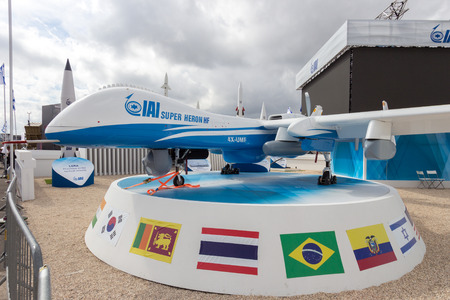 israel war: PARIS-LE BOURGET - JUN 18, 2015: IAI Super Heron heavy fuel multi-role unmanned aerial vehicle (UAV) on display at the 51st International Paris Air show