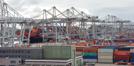 hinterland: ROTTERDAM, NETHERLANDS - SEP 6, 2015: ECT Container terminal in the Port of Rotterdam. The port is the largest in Europe and facilitate the needs of a hinterland with 40,000,000 consumers. Editorial