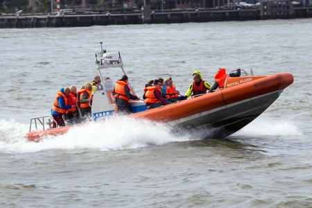 coastguard: ROTTERDAM, NETHERLANDS - SEP 5, 2015: Rescue boat of the Dutch rescue service KNRM Koninklijke Nederlandse Redding Maatschappij during the World Harbor Days