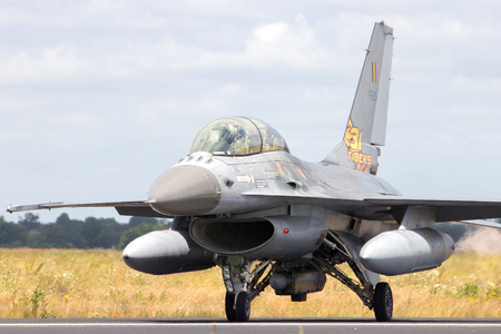 nato: SCHLESWIG-JAGEL, GERMANY - JUN 23, 2014: Belgian Air Force F-16 fighter jet during the NATO Tiger Meet at Schleswig-Jagel airbase. The Tiger Meet is to promote solidarity between NATO air forces