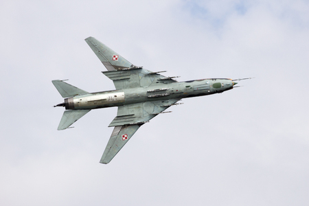 modern fighter: VOLKEL, NETHERLANDS - JUN 15, 2013: Polish Air Force Sukhoi Su-22 bomber plane flyby at the Dutch Air Force Open Day. Editorial