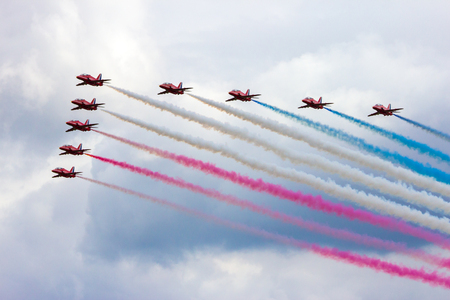 air show: VOLKEL, THE NETHERLANDS - JUN 15, 2013: The RAF demonstration team Red Arrows performing at the Dutch Air Force Open Day.