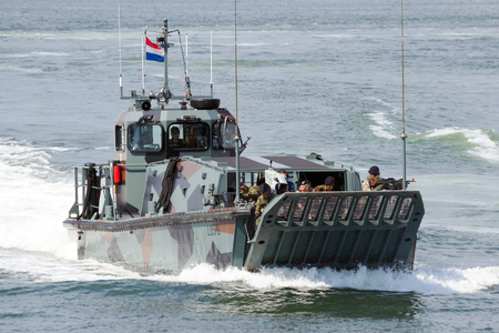 military invasion: DEN HELDER, THE NETHERLANDS - JULY 7, 2012: Dutch Marines in a Landing craft during an amphibious assault demo during the Dutch Navy Days.
