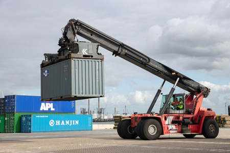 handler: ROTTERDAM, NETHERLANDS - SEP 6, 2015: Mobile container handler in action at a container terminal in the Port of Rotterdam
