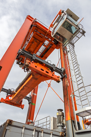 stacker: Straddle carrier for moving containers in a shipping port