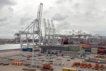 facilitate: ROTTERDAM, NETHERLANDS - SEP 6, 2015: ECT Container terminal in the Port of Rotterdam. The port is the largest in Europe and facilitate the needs of a hinterland with 40,000,000 consumers
