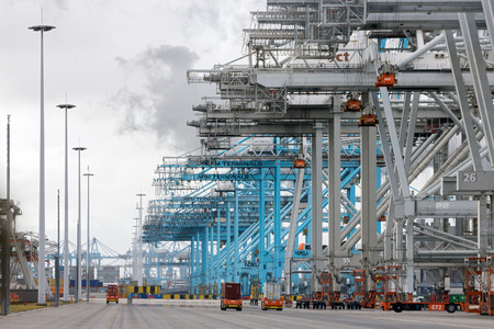 dockside: ROTTERDAM, NETHERLANDS - SEP 6, 2015: ECT and APM Container terminal in the Port of Rotterdam. The port is the largest in Europe and facilitate the needs of a hinterland with 40,000,000 consumers. Editorial