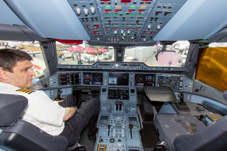 15 18: PARIS - JUN 18, 2015: Qatar Airways Airbus A350 XWB cockpit. Qatar Airways is the first user of the A350 with its first flight on 15 January 2015. Editorial