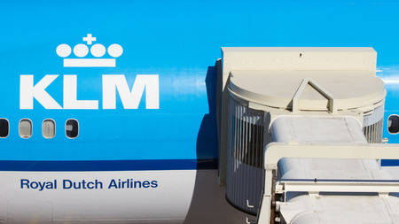 disembark: AMSTERDAM, NETHERLANDS - SEP 9, 2012: Passenger jet bridge connected to a KLM airliner at Schiphol Airport.
