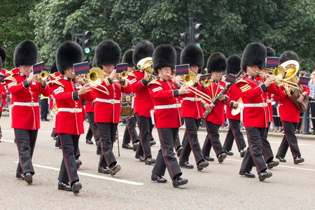 parades: LONDON - JUL 1, 2015: British Royal guards performing the Changing of the Guard at Buckingham Palace. The ceremony is one of the top attractions in London and UK military traditions.