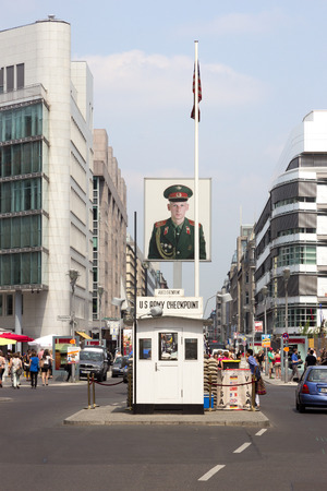 allied: BERLIN, GERMANY - MAY 23, 2014: Tourists around the former Allied checkpoint Charlie. Nowadays this site is a tourist attraction. Editorial